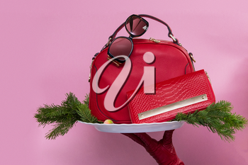 Red Female accessories on pink background, new year theme