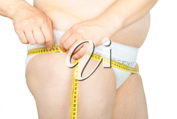 Fat woman measuring her hips