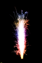 Gradient colorful birthday fireworks candle over black