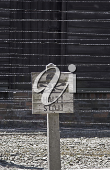 Caution sign board (DOF) in Auschwitz concentration camp, Poland