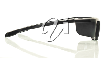 Stereo 3D TV: side view active shutter glasses over white background