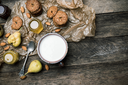 ears Cookies Almonds and milk on wooden table. Rustic style and autumn food photo