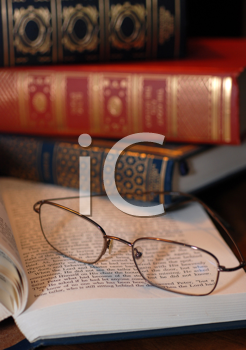 Royalty Free Photo of a Reading Glasses and Old Books