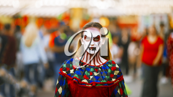 Jackson, USA-September 24, 2016: Street performer in Halloween costume and makeup is entertaining crowds.
