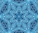 Bright blue abstract concentric pattern with soap foam on glass