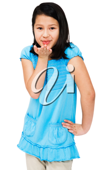 Girl blowing a kiss and smiling isolated over white