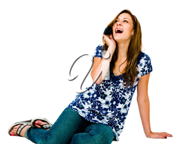 Beautiful teenage girl talking on a mobile phone isolated over white