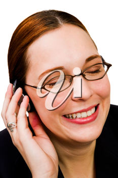 Businesswoman listening to music on a headphones and smiling isolated over white