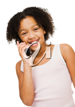 Girl talking on a mobile phone isolated over white
