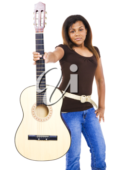 Girl showing a guitar and posing isolated over white