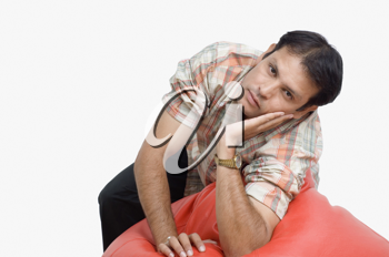 Man leaning on a bean bag and thinking
