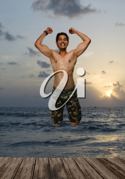 Portrait of a young man jumping with joy