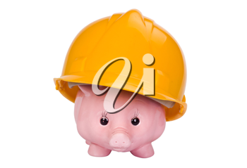 Close-up of a piggy bank with a hardhat