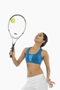 Woman holding a tennis racket with a ball