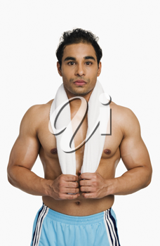 Man standing with a towel around his neck