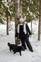 Royalty Free Photo of a Woman and a Dog in the Forest