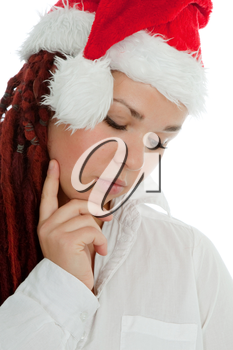 Portrait of young modern girl wearing Santa Claus hat isolated on white background.