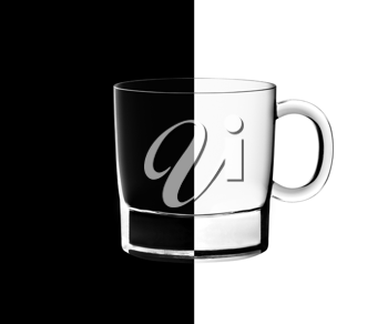 Royalty Free Photo of an Empty Cup on a Half Black, Half White Background