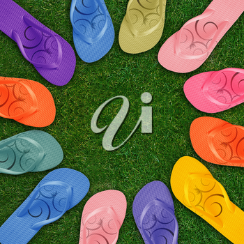 Colorful Flip Flops on green grass with copy space.
