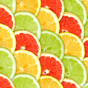 Abstract three-color background with citrus-fruit of grapefruit, orange and lemon slices. Close-up. Studio photography.