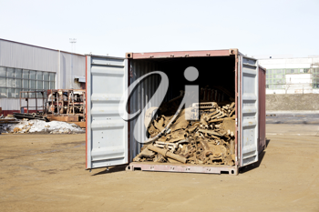 Royalty Free Photo of Scrap in an Open Container