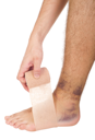 Royalty Free Clipart Image of a Man Bandaging a Sprained Ankle