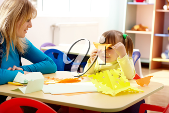 Royalty Free Photo of a Little Girl and Teacher