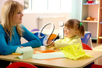 Royalty Free Photo of a Little Girl and a Teacher in Preschool