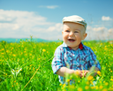 Royalty Free Photo of a Little Boy in the Meadow