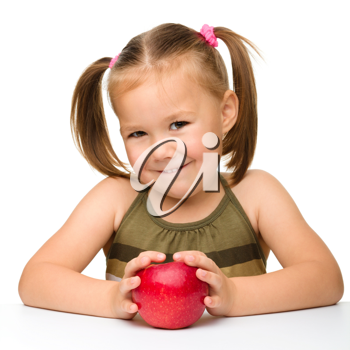 Royalty Free Photo of a Little Girl With an Apple