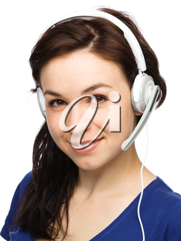 Closeup portrait of lovely young woman talking to customers as a consultant using headset, isolated over white