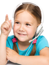Cute young girl is working as an operator at helpline talking using headset, pointing with her finger up, isolated over white