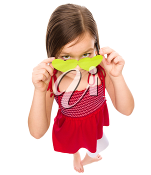 Little girl is looking over her heart-shaped glasses, fisheye portrait, valentine concept, isolated on white