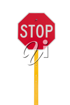 stop sign with reflective surface on yellow pole isolated on white background
