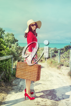 beautiful lady in red  near the sea in retro style
