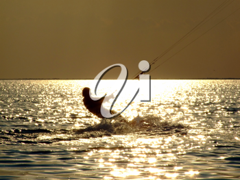 Royalty Free Photo of a Kitesurfer at Sunset