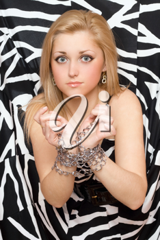 Royalty Free Photo of a Woman With Chains on Her Hands