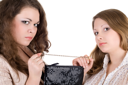 Royalty Free Photo of Two Girls Fighting Over a Handbag