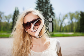 Portrait of pretty blond girl wearing sunglasses