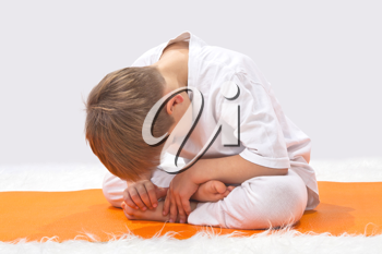 Royalty Free Photo of a Little Boy Doing Yoga