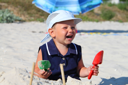 Royalty Free Photo of a Little Boy Playing on the Beach