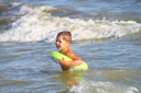 Royalty Free Photo of a Little Boy in the Water