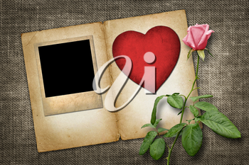 old-style photo  with red paper heart with pink rose  in vintage style