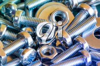 Chrome bolts and nuts close-up with colorful tone