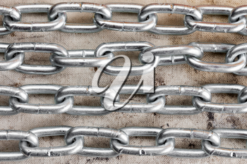 Four chains crossing old dirty canvas  background
