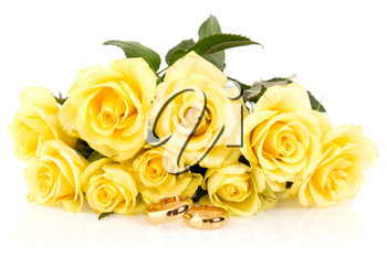 Wedding rings with bunch of roses isolated on white background