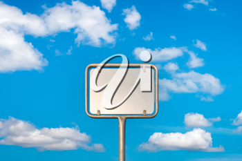 Blank metal sign post against blue sky, put your own text here