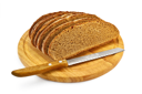 Sliced rye bread on a round board with a knife isolated on a white background