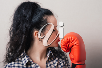 businesswoman with boxing gloves ready for fighting