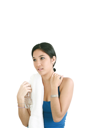 Portrait of young happy smiling woman in sportswear holding bottle of water, isolated on white background